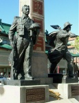 Memorial dedicated to Chinese-Canadians who served in World War II. Secondary theme of the Chinese railway workers' efforts is depicted by right hand sculptured figure with a shovel. Vancouver, BC. Photo by J. Chong 2010.