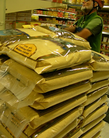 Stacks of large couscous sacks and different types at Middle Eastern shops.