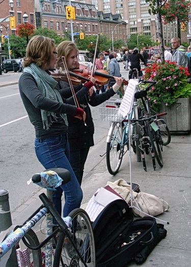 Violin buskers at St. Lawrence Market, Toronto 2011. Photo by J. Chong