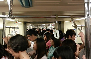 Commuter train crowds in Taipei, Tawain 2011. Photo by HJEH Becker