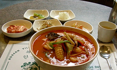 Spicy Korean seafood noodle soup with condiments 2012. Calgary, AB. Began exploring other Asian cuisines, outside of Chinese Cantonese food starting in my mid 20's.