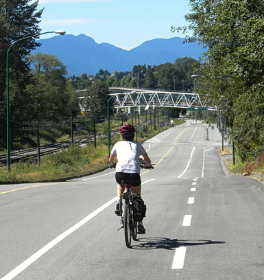 Cycling towards Sperling Station bike-pedestrian bridge.Burnaby BC 2009. Photo by HJEH Becker