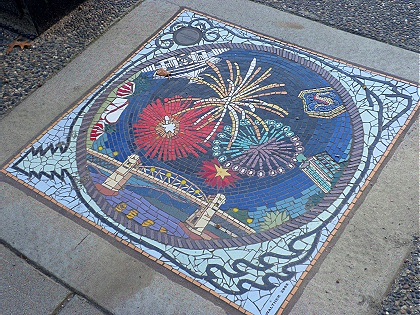Sidewalk mosaic with fireworks over Burrard Bridge, Vancouver BC 2010. Artist: Bruce Walther. Photo by J. Chong.
