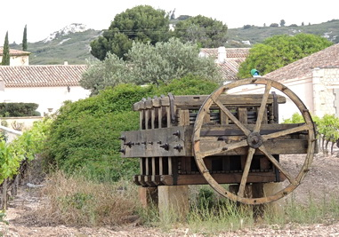 Antique wooden grape press by a French vineyard. Provence, France 2012. Photo by J. Becker