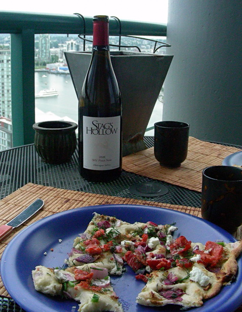 Homemade focaccia-pizza with bottle of merlot wine from a Okanagan Valley winery in B.C. Photo by J. Chong