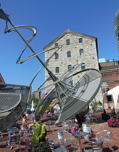 Arresting outdoor art sculpture at Gooderham Distillery district. East of St. Lawrence Market near Waterfront Trail. Toronto ON 2012. Photo by J.Chong. Heritage area of former distillery buildings now into shops, public square for pedestrians and light cycling.