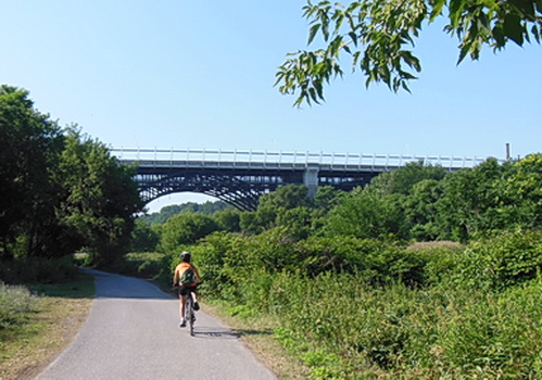 Cycling lower Don River bike path with Bloor St. Viaduct in distance. Part of daily 30 km. round trip bike commuting route between workplace, downtown Toronto and Scarborough home. 2012