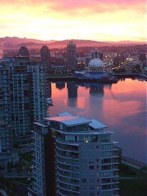 False Creek at sunrise. Looking out towards Science World. Olympic Village on right. Vancouver BC. Photo by J. Chong