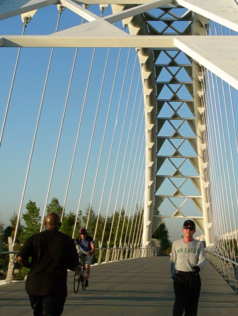 Jogging and cycling on Humber River bridge in Toronto's west-end near Etobicoke. Along the Waterfront Trail. Photo by J.Chong 2011.