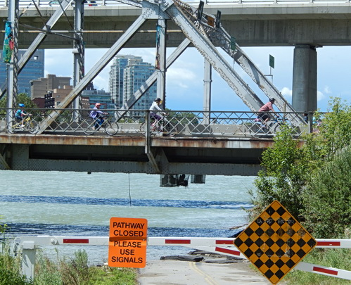 Cycling underpass closed under Langevin Bridge after Bow River flood waters rose to the underside of bridge.  2013 Photo by J. Chong