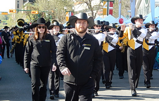 Local marching band's attire requires a black Stetson cowboy hat --year round. Calgary AB May 2014.