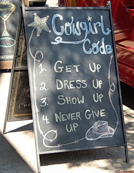 Sign outside women's fashion clothing store. Calgary, AB 2014.