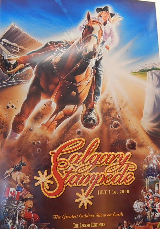 A rare year when annual Calgary Stampede poster  featured a female horse rider. Most years predominantly male horse riders / cowboys. An occasional male-woman couple on horse graces some years. Permanent historic poster display by a transit station. Calgary AB.