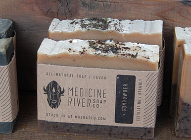 Alberta handmade soap with bison company logo. Gunpowder probably a natural exfoliating powder.