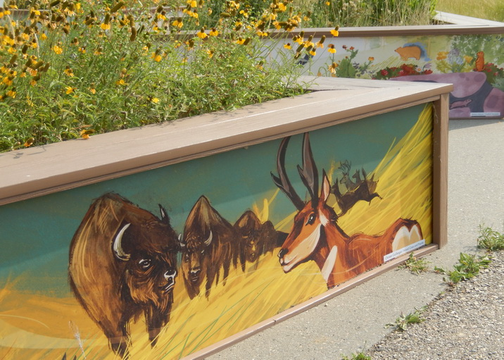 Art decorates around planters at Inglewood Bird Sanctuary. Calgary AB 2015. Photo by J. Chong