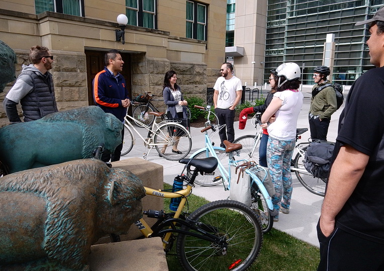 Herd of cyclists by herd of bison sculptures. Albert Courthouse, downtown Calgary, AB 2016. Photo by J.Chong